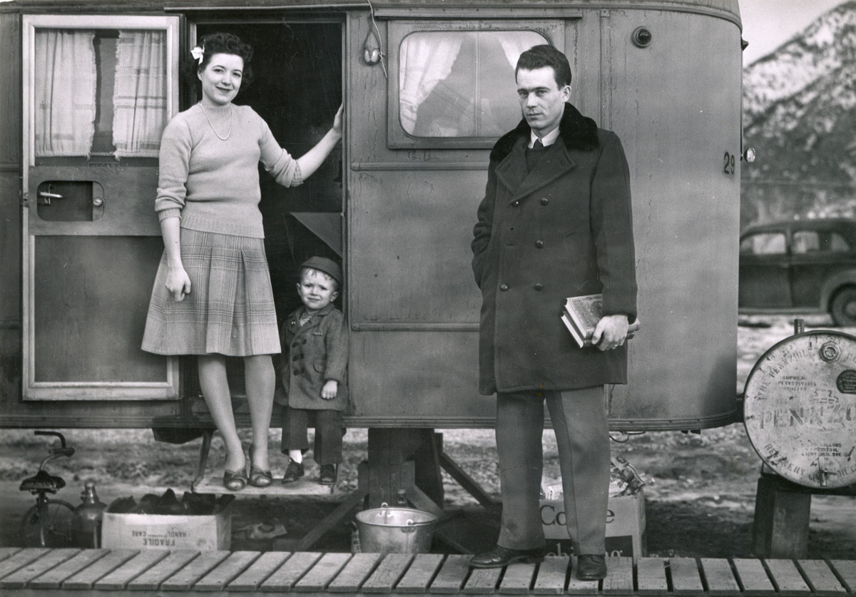 Family at the door of a trailer, 1940s