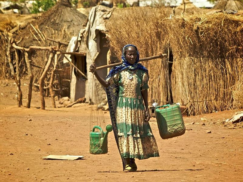 Kunama woman carrying water in Shimelba Refugee Camp