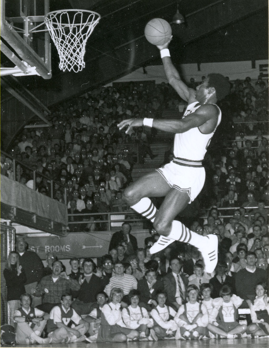 A Utah State University basketball player dunking the ball, c. 1970.