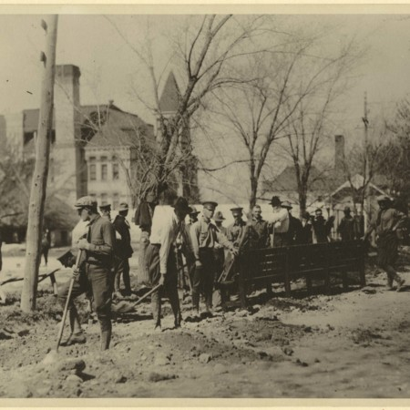 Students putting in a sidewalk for 'A-Day,' 1919