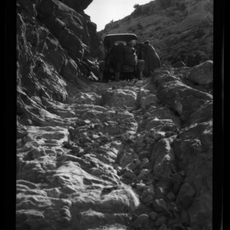 Group with Dolph Andrus and  William H. Hopkins pushing Maxwell automobile up Comb Ridge, just outside of Bluff, Utah.