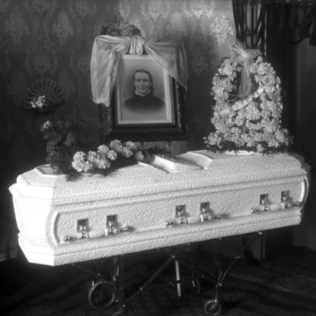Casket with portrait and flowers