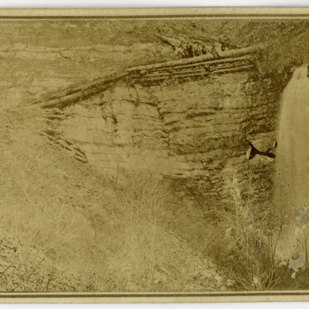 """""""Battle Creek Canyon Falls,"""" a group of people standing at the top of the falls"""