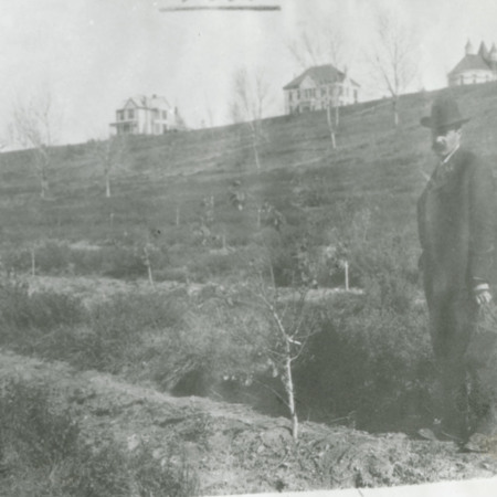Unknown man standing on Old Main Hill, c. 1892