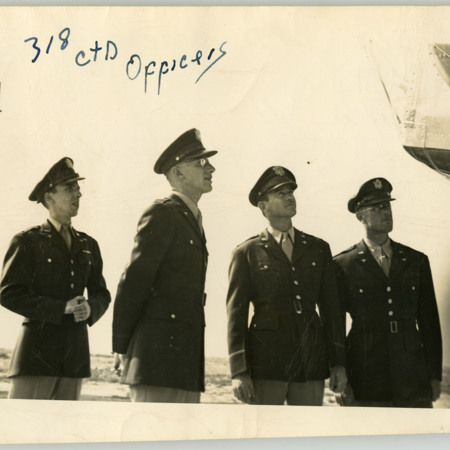 Officers of the 318th CTD Inspect an Airplane