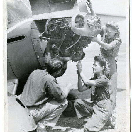 Female Students Work on Piper Cub Engine
