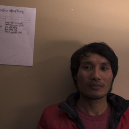 Eh Htoo with dinner schedule written in Burmese