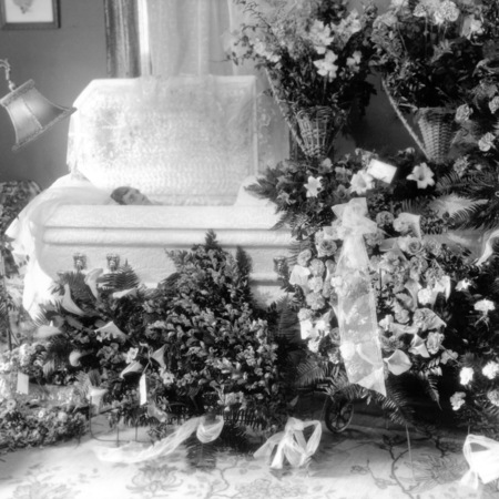 Casket and funeral flowers