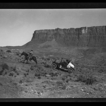 Single horse, with rider, pulling the Maxwell automobile