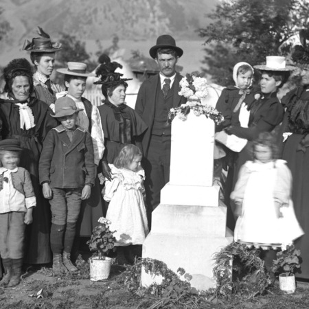Mourners around a headstone in Brigham City, Utah