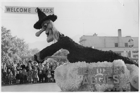 Homecoming parade float: Bewitch 'Em Aggies, 1956