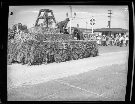"""Fallen Cowboy"" float in the Homecoming parade, 1950"