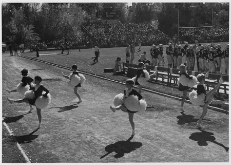 Cheerleading at the homecoming game, 1964