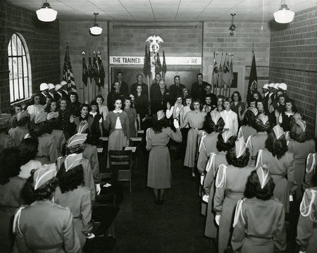 Young women being sworn into the Sponsor Corps