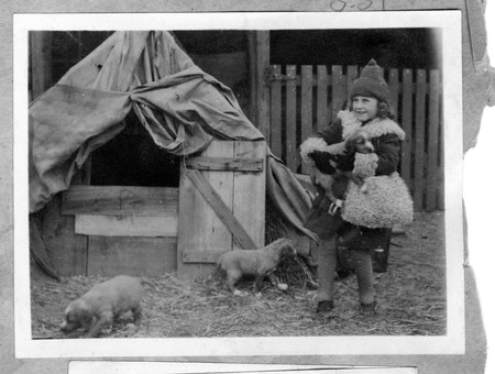 Helen Becker with Puppies; c. 1912