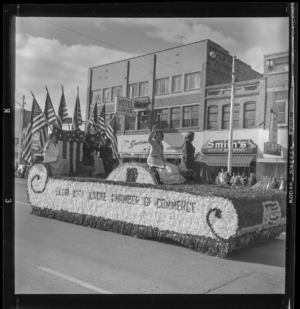 Chamber of Commerce representatives on a parade float, 1965