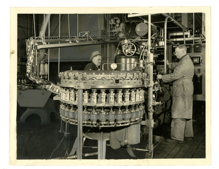 Two Becker Employees Canning Beer, c. 1940
