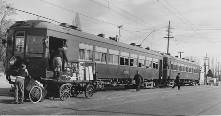 U.I.C. Engine #513 and Passenger Car Unloading/Loading Freight in Logan, Utah, 1930-1940<br />