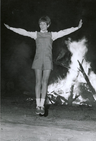 Songleader, probably Linda Watterson, cheering, circa 1969